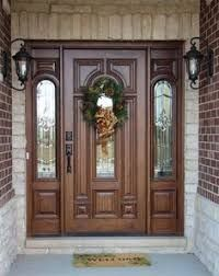 Image result for entrance doors with ganesh designs