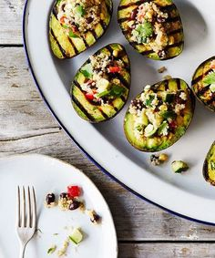 Food 52 - #Vegan Grilled Avocado With Quinoa Salad | This avocado and quinoa combination is the perfect summertime dish. #refinery29 http://www.refinery29.com/food-52/96