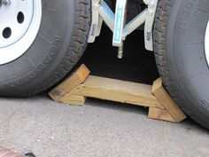 """A pair of chocks that are sturdy and can be thrown down in an instant. They fit between the tires with about ½"""" to spare. The best part is that they can't flip up out of the way if a tire rolls onto them."""