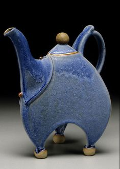 Sandy & Ann Batton | Piedmont Craftsmen | What a quirky blue ceramic tea pot! Looks like it could dance.