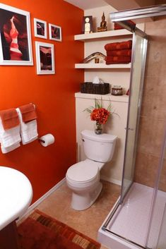 Orange and blue bathroom accessories orange red white and blue bathroom accessories . orange and blue bathroom accessories aqua bathroom accessories coral Orange Bathroom Paint, Aqua Bathroom, Eclectic Bathroom, Diy Bathroom Decor, Bathroom Colors, Small Bathroom, Bathroom Ideas, Basement Bathroom, Bathroom Shelves
