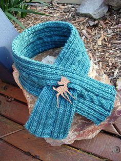 Cable knit keyhole scarf.  Ravelry.com.  Used this pattern to make a scarf for the girls.