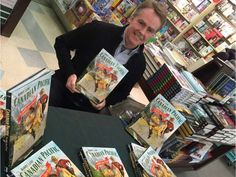 Barry Lane is surrounded by copies of his book, Canadian Pacific: The Golden Age of Travel, at Coles bookstore in Regina's Northgate Mall on Nov. 20, 2015.