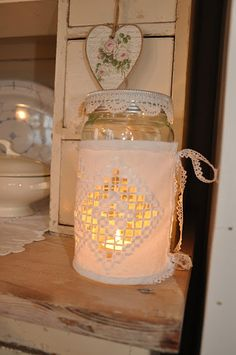 Jar sleeves Hardanger - Pretty!  I have seen a candle sleeve that is very similar.