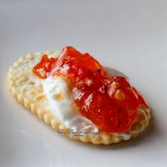 Spicy Red Pepper Jelly hors d'oeuvres and what looks like cream cheese