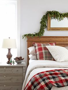 Add holiday cheer by draping a garland above a headboard and stashing a bowl of pinecones next to a bed.
