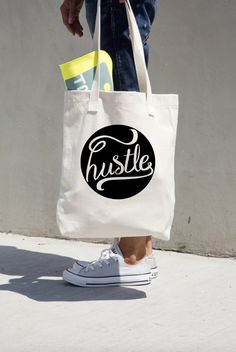Hustle Tote Bag Canvas Market Totes Work Book Library Gift for Boss Coworker Hustle Quote Cotton Carryall Black Minimalist Motivational by PrettyPennyPrints on Etsy https://www.etsy.com/listing/258855745/hustle-tote-bag-canvas-market-totes-work