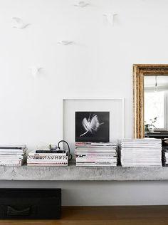 concrete ledge with stacks of magazines / sfgirlbybay