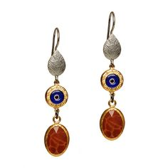 "Stay chic and safe with the Cami Earrings. Featuring marbled carnelian set in gold plate, a protective & stylish evil eye and a finely crafted antique silver leaf, the Cami Earrings are playful and eye catching. Wear them everyday and welcome good fortune into your life!   - Sterling silver, vermeil, carnelian   - 2"" long   - Fish hook earwire"