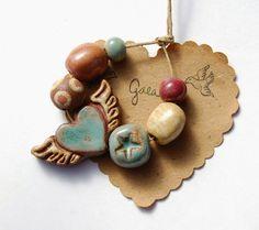 Gaea Ceramic Bead and Art Studio Blog - Fly where your love takes you. Handmade ceramic winged heart bead set. gaea.cc