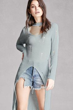 A distressed open-knit sweater featuring a cutout below the choker neckline, long sleeves, a split-front, and a longline silhouette. This is an independent brand and not a Forever 21 branded item.