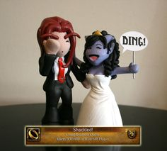 A World of Warcraft wedding topper...I would NEVER use this as my topper but maybe to have on grooms cake or just alittle something for Mike:-)