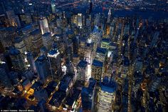 """NEW YORK BY NIGHT:  """"Captured at night from around 1000ft above the ground, these spectacular aerial images show the city as it has rarely been seen before."""""""