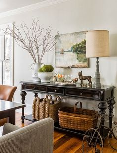 """Console styling: Branches or Botanicals. One of my favorite things from nature to add to any vignette are branches. In any season, they are tall and sculptural and reach up high into vertical wall space adding organic appeal. But anything botanical works on a console table and adds that """"something living"""" element such as a small vase of flowers or a collection of succulents or a just a few yard clippings from a favorite perennial."""