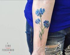 Cornflower tattoo on the right inner forearm. Tattoo Artist: Elena Fedchenko