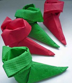 15 Most Easiest DIY Christmas Napkins To Adorn Your Christmas Table A festive napkin folding tutorial for elf shoe napkins Diy Christmas Napkins, Christmas Napkin Folding, Origami Christmas, Noel Christmas, Winter Christmas, All Things Christmas, Christmas Cover, Christmas Drawing, Christmas Table Settings