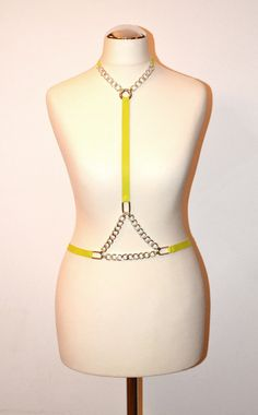 Electric yellow harness wuth silver chain triangles https://kivaleatheraccessories.wordpress.com/2015/01/20/cool-leather-harnesses-by-kiva/