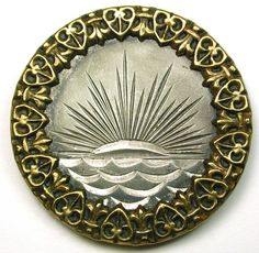 Antique Button Sun Setting over Ocean Scene w/ Fancy Brass Border   Circa 1880s. Very good condition.  Measures 1  7/16 inch.  SOLD $48.99