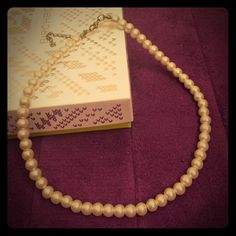 1950's Style Costume Pearls Charming strand of high quality costume pearls. I'm not positive what they're made of, but it's much nicer than plastic. Perfect for a costume or retro themed outfit! Jewelry Necklaces