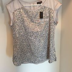 NWT Polka dot top limited top New with tags from the limited. Bought this summer too big on me now. Gray top with silky top portion and black dots. The main section has black, blue, purple, white, and yellow dots. Sad to see this didn't work for me. The Limited Tops