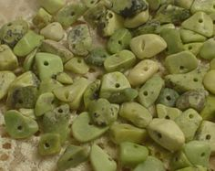 $2.25 No quantity listed.  Light Green Serpentine Chip Bead Natural Stone