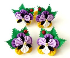 The flowers are made in the technique of tsumami kanzashi. Alligator type hair clips with non-slip grips. Flowers are made from grosgrain ribbons. Flower`s d~ 2 inch ( 5 cm).  At your request can be made a fower of different coor combinations.  My handworks can be a unique gift for you, your family and friends!  For more items, please visit my shop home: http://www.etsy.com/shop/JuLVa