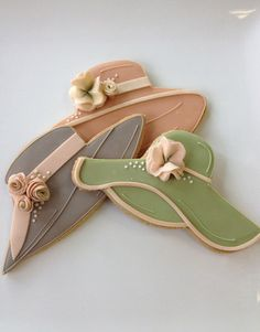 I love these pretty hat cookies! Not sure the cookie cutters used but very similar to ecrandal.com cookie cuttter hats. http://stores.ecrandal.com/search.php?search_query=ladies+hats&x=0&y=0