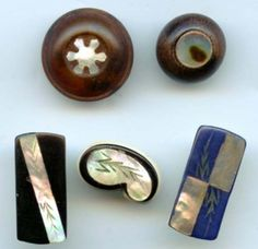 Horn, wood, celluloid with inlay pearl buttons--lot sold for $15.