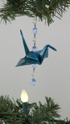 Origami Crane Ornament:  I'm sure I still have origami paper in my craft box.  I'm going to make some for the tree next year.