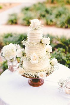 A cake like this with purple icing...I just love the baby's breath around each layer.