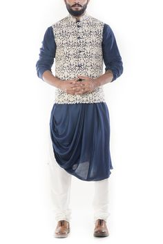 Featuring a royal blue cowl drapped kurta with a cream waistcoat and white churidar. The jacket has beautiful dori embroidery on it. Wedding Dresses Men Indian, Wedding Dress Men, Wedding Suits, Wedding Attire, Wedding Updo, Wedding Wear, Nehru Jacket For Men, Nehru Jackets, Men's Jackets