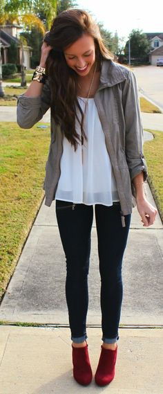 I just love everything about this outfit. Dressy blouse, skinny jeans, gray utility jacket, jewelry to dress it up, and I LOVE a red shoe/boot!