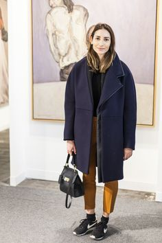 19 New Yorkers Who Make Street Style An Art #refinery29  http://www.refinery29.com/2015/03/83381/the-armory-show-art-fair-nyc-street-style#slide-8  Name: Sarah AkkariJob: CEO, Senteurs d'Orient USAWhat She's Wearing: Balenciaga coat and bag, 3.1 Phillip Lim pants, and Nike sneakers.Akkari, accompanied by her sister and friends, hit the Armory Show to see the wide array of artists on display from her home country of Lebanon (like this Marwan Rechmaoui painting).