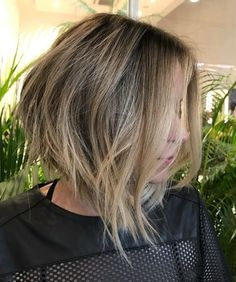medium layered haircut with bangs