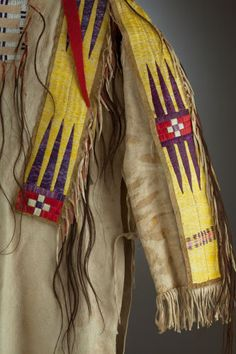 American Indian Art:Beadwork and Quillwork, A PLAINS QUILLED HIDE WAR SHIRT. Once Belonging to Sioux Chief RunsThe Enemy. c. 1880...