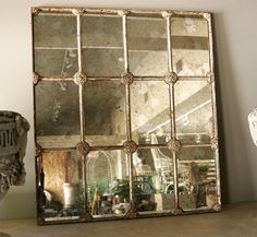19th century French window frame converted into a mirror.  Marsh Garden Décor, New Orleans