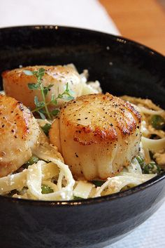*LEMON-RICOTTA PASTA W/ SEARED SCALLOPS* Cook pasta until al dente.  Rinse scallops & pat dry. Heat 1 tbsp olive oil & 1 tbsp butter over high heat until foamy. Sprinkle scallops w/ little salt & pepper. Cook, turn once until brown on outside & opaque in center, 2 min per side. Drained pasta and cook in low heat. Stir in lemon zest, juice, remaining 3 tbsp olive oil, peas, & thyme. Toss to coat, then season w/ salt & lots of pepper. Add the ricotta & mix gently until pasta is coated evenly.