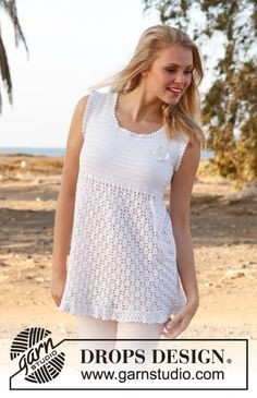 """Crochet DROPS tunic with lace pattern, flounce at the bottom and butterfly for decoration in """"Cotton Viscose"""". ~ DROPS Design"""