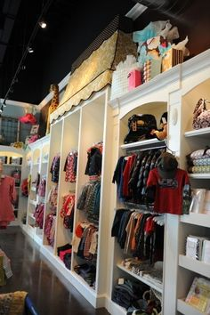 Wall display - lots of adjustable shelves, drawers and waterfall hanging units.  oopsie daisy boutique