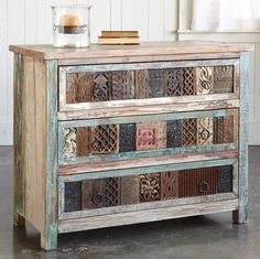 """Functional and fabulous, vintage carved wood blocks front our chest with three roomy drawers. Handcrafted of reclaimed wood, with random vintage paint intact. Planked top, iron pulls. Block patterns and colors will vary. Imported. Ships from our supplier in 2 to 4 weeks. Additional shipping, $350. 40""""W x 18""""D x 32""""H."""