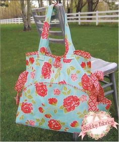 "Grab and Go Bag: This great pattern includes instructions for three projects: the Grab and Go Bag and two mats, sizes 18"" x 24"" and 24"" x 24"".  Use this as a diaper bag/changing mat combo, or a picnic bag and table mat.  The possibilities are endless!"