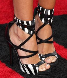 Ashley Tisdale wearing hot zebra heels from Jimmy Choo #jimmychooheelsred