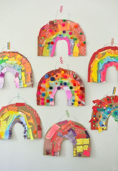 Children use colored collage material to make a rainbow from cardboard. #Rainbows