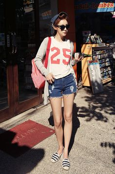 Cute look with the white tee shirt, cardigan, dark ripped denim shorts,and striped shoes.