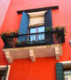 Venice window - #Orange and #blue shutters with a beautiful balcony.