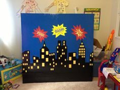 Superhero backdrop blue tablecloth from DT with black and yellow poster board to…