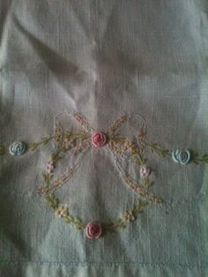 Vintage linen white tea towel, pink, blue and green flowers on Etsy, $4.00