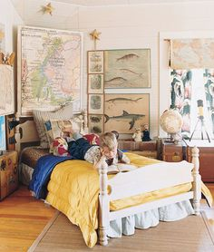 boy boy's child child's kid kid's bedroom wood wooden panel bed four poster colorful naturalist map maps classic traditional bookish anthropologist cool globe trunk