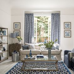 Love coastal living rooms? Create the perfect scheme with nautical stripes and beautiful blue hues that will take you back to sunny days by the sea