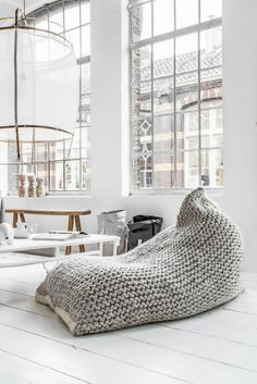 Comfy cushion in grey via Vosgeparis